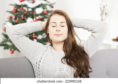 young cute girl is relaxing after busy christmas stress