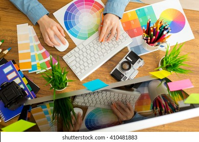 Young cute Graphic designer using graphics tablet to do his work at desk - Shutterstock ID 410481883