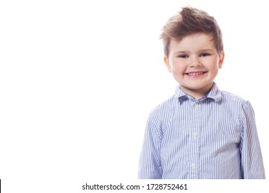 Young cute happy little boy posing on white background.