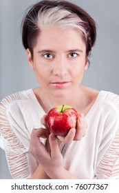 Young cute lady holding red apple
