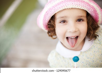 Young cute little girl gesturing with her mouth
