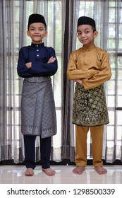 Young cute muslim boys  in Malay traditional  clothes during Eid Fitr.  Eid Fitr, Eid Adha , Happiness & Forgiveness Concept.