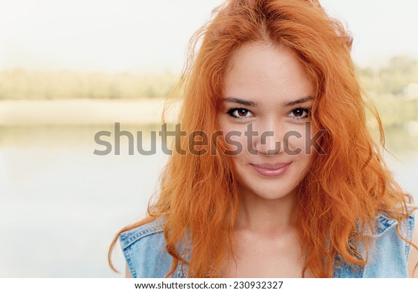 Young cute red haired girl pourtrait a lot of copyspace