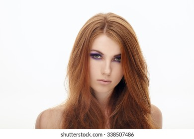 Young cute redhead woman with violet smokey eyes makeup isolated