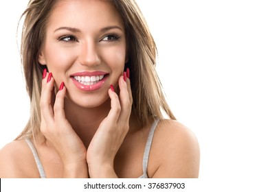 Young cute smiling girl with perfect white teeth on white background
