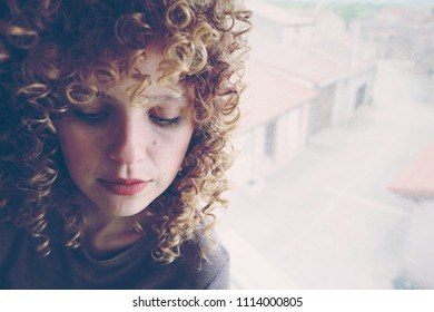 Young and cute woman against a window