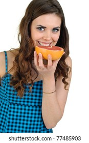 young cute woman in blue dress with fruit