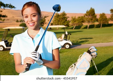 A young, cute woman golfer ready to hit on the fairway