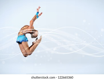 Young cute woman in gymnast suit show athletic skill on white background