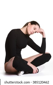 Young cute woman in gymnast suit resting on white background