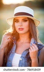 Young cute woman outdoors portrait.