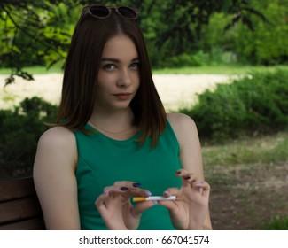 Young cute woman, stop smoking
