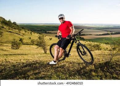 Young cyclist cycling in the spring meadow. Active life conception