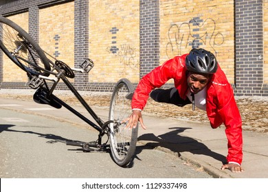 young cyclist having an accident on his bike