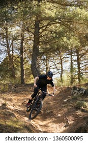 Young cyclist with mountain bike. Bike rider in a mountain in sunny day.