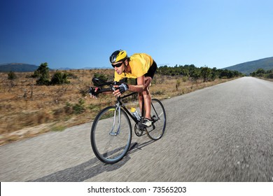 A young cyclist riding a bike on an open road