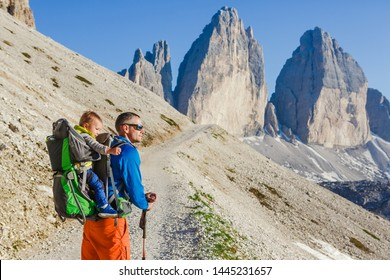Young dad with baby boy travelling with backpack. Father on hiking adventure with child, family trip in mountains. Vacations journey with infant National Park Tre Cime di Lavaredo, Dolomites, Italy