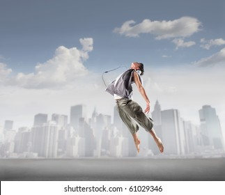 Young dancer jumping with cityscape on the background