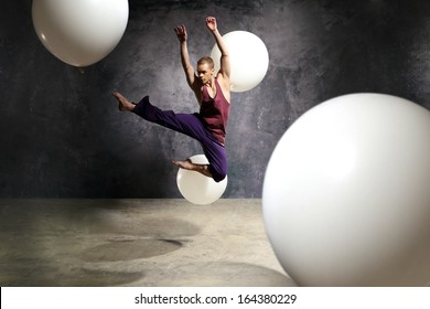 Young dancer is jumping on stage / Dancer in the jump