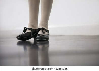 Young dancer in tap shoes... low angle shot of just feet and legs