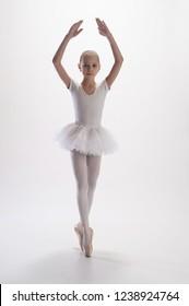 Young dancer wearing a tutu.