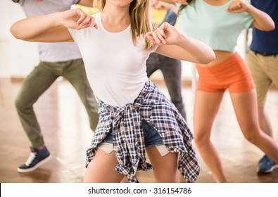 Young dancing people in gym during exercise dancer workout training with happy fresh energy.
