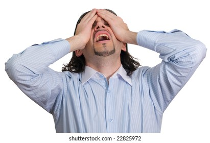 Young dark haired businessman in light blue striped shirt screams in despair and covers eyes with hands isolated on white