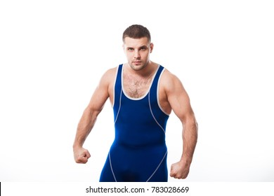 A young dark-haired man fighting Greco-roman wrestling, grappling in a blue wrestling tights posing on white isolated background