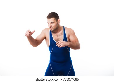 A young dark-haired man fighting  wrestling, grappling in a blue wrestling  clothes posing against a white isolated background