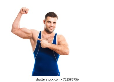 Young dark-haired man wrestling Greco-Rican wrestling, master of sports in grappling in blue wrestling tights smiling and  demonstrate his bicep white isolated background