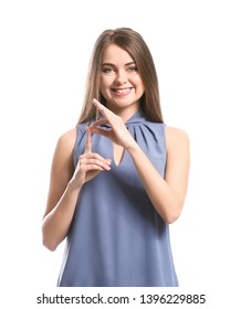 Young deaf mute woman using sign language on white background