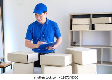 Young delivery man check the box before sending product.