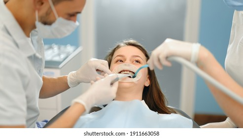 Young dentist wearing optragate for the young patient, preparing for the dental checkup. Regular visit to the orthodontist. 4k video screenshot, please use in small size