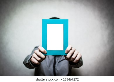 A young depressed man holding the picture frame, colored
