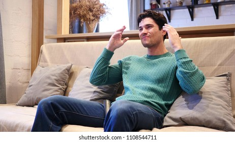 Young Depressed Man Upset by Loss while Watching Match on TV