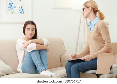 Young depressed woman at psychologist's office
