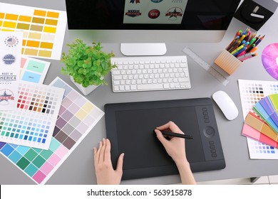 Young designer drawing sketches on graphic tablet, closeup