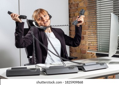 Young desperate female employee, who works as a service consultant, is completely overwhelmed due to the many telephone inquiries and searches in vain for a solution
