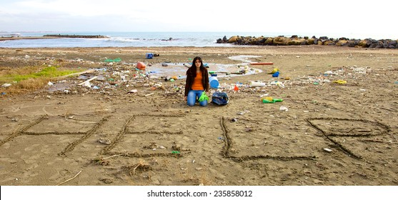 Young desperate woman not able to clean beach
