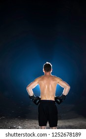 Young determined boxer preparing for his training and a fight