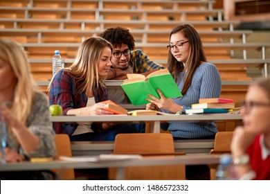 young student's discussion and writing together at college