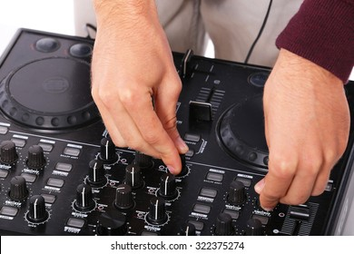 young disk jockey hands mixing on sound mixer