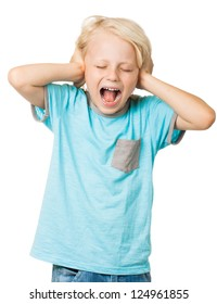 A young distressed young boy screams with his eyes shut and covers his ears with his hands. Isolated on white.