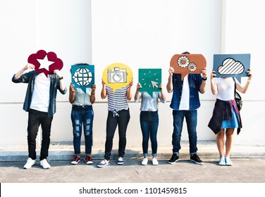 Young diverse friends holding social media icons