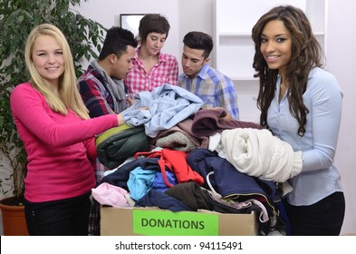 young and diverse volunteer group with clothing donation