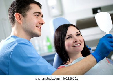 young doctor dentist examines the mouth of the patient