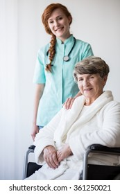 Young doctor and female patient on wheelchair