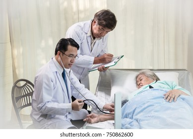 Young doctor have treatment for elderly woman patient