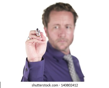 Young doctor holding marker over white background