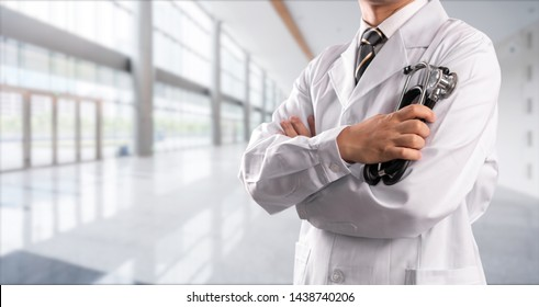 young doctor with hospital background